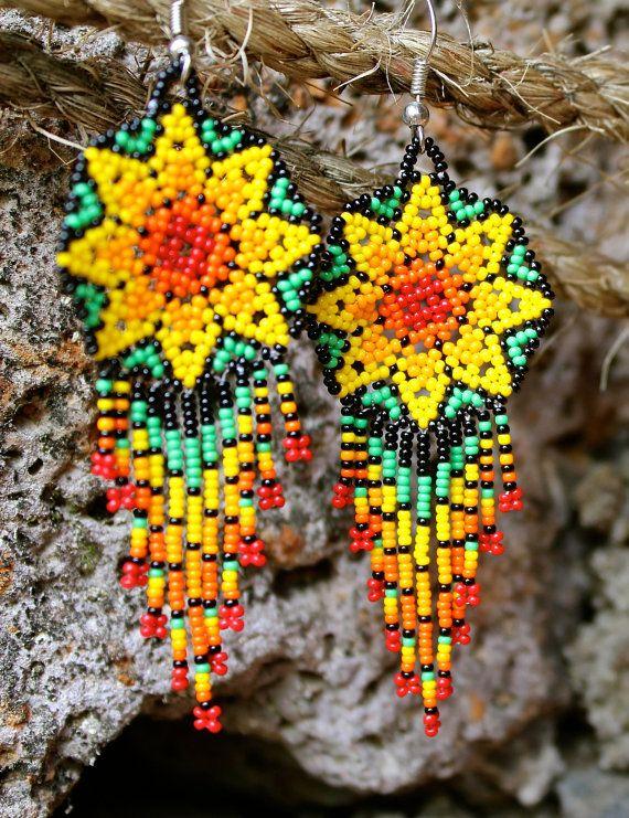 Beaded Huichol earrings in star/flower designs by Terreno on Etsy
