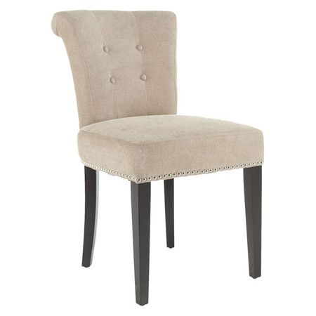 A timeless addition to your dining room or kitchen decor, this classic side chair pairs a birch wood frame with button-tufted upholstery and nailhead trim.  ...