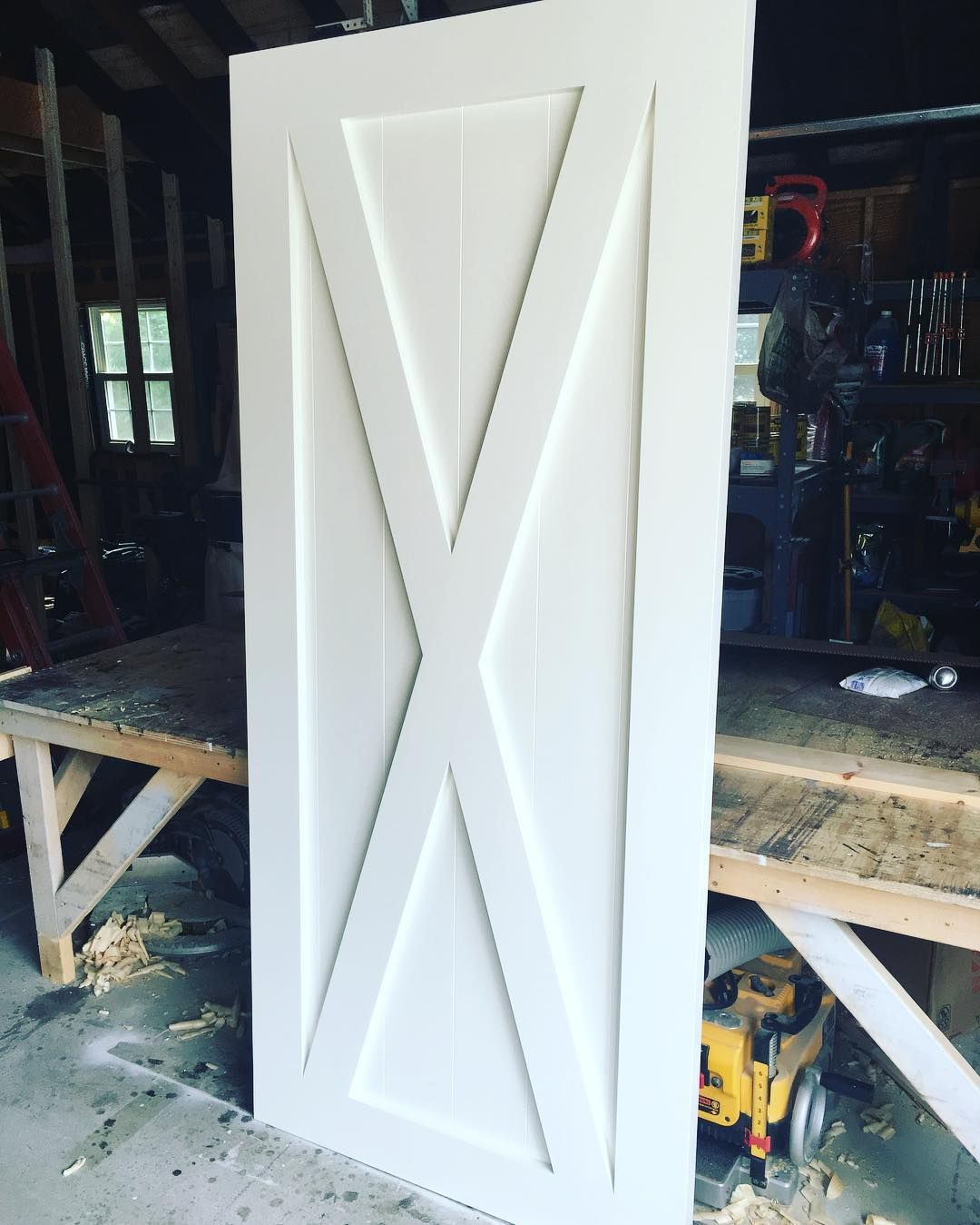 We love this poplar, painted X-Brace with Border barn door - the perfect combo…
