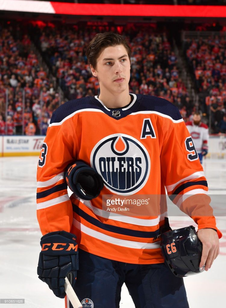 Ryan Nugent-Hopkins of the Edmonton Oilers stands for the singing of the  national anthem prior to the game against the Montreal Canadiens on  December 23 f0eed0328