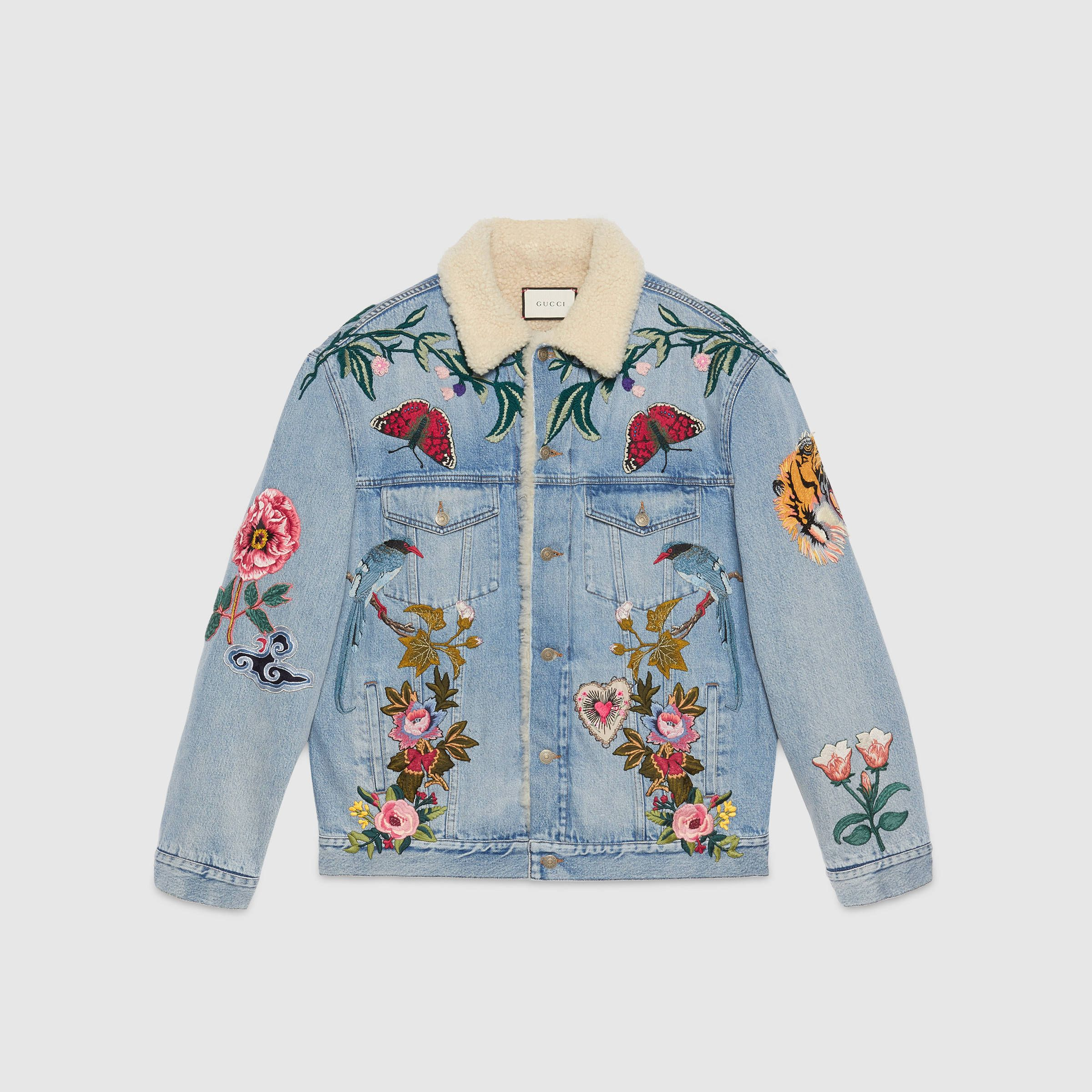 7229b9bd375 Shop the Embroidered denim jacket with shearling by Gucci. Inspired by a  patched denim jacket