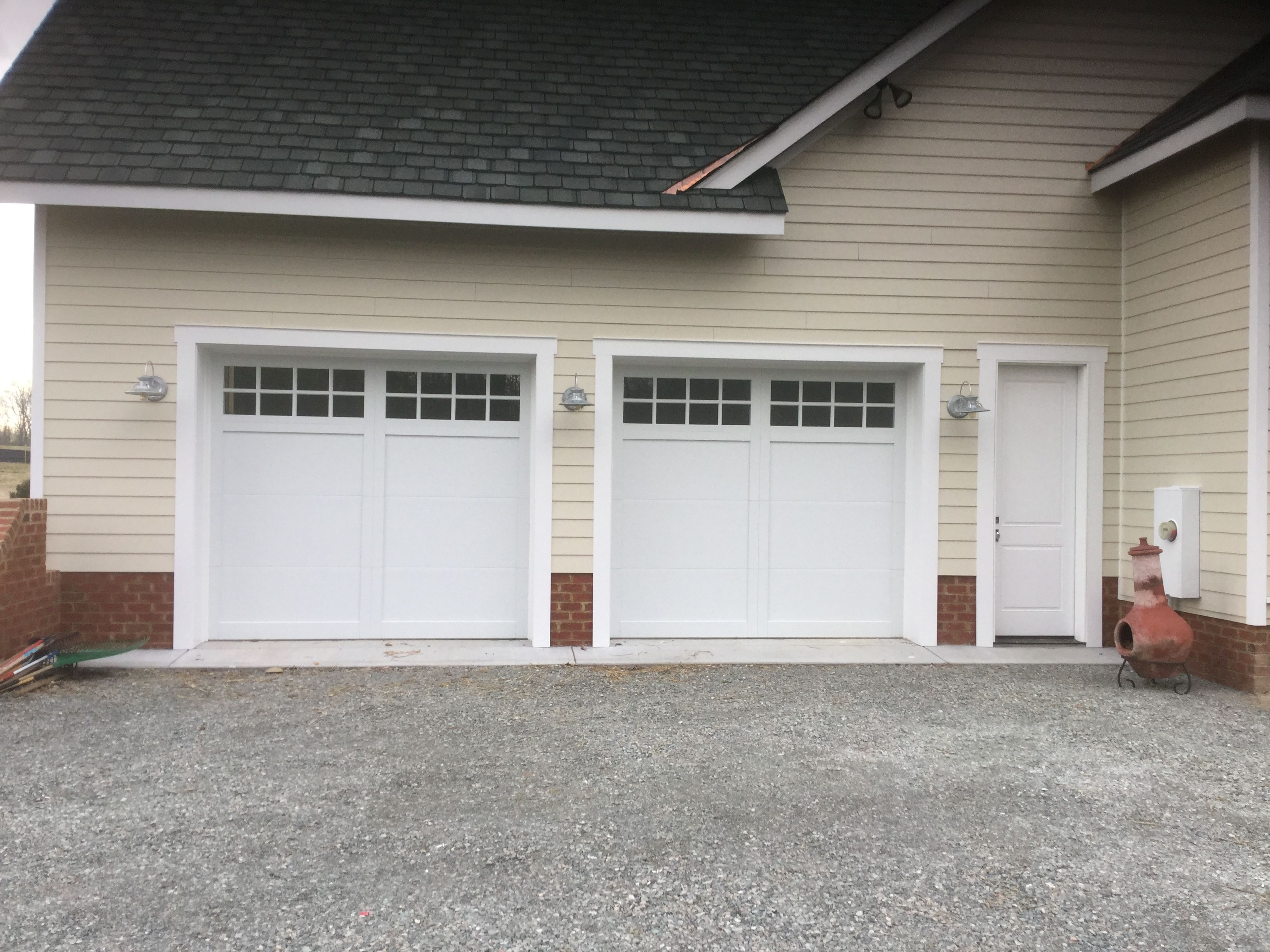 Two 9x8 Model 5331 Double Steel Insulated Garage Doors With Fiber Poly Accent Batten Overlay And Top Stockton Garage Door Insulation Glass Design Garage Doors