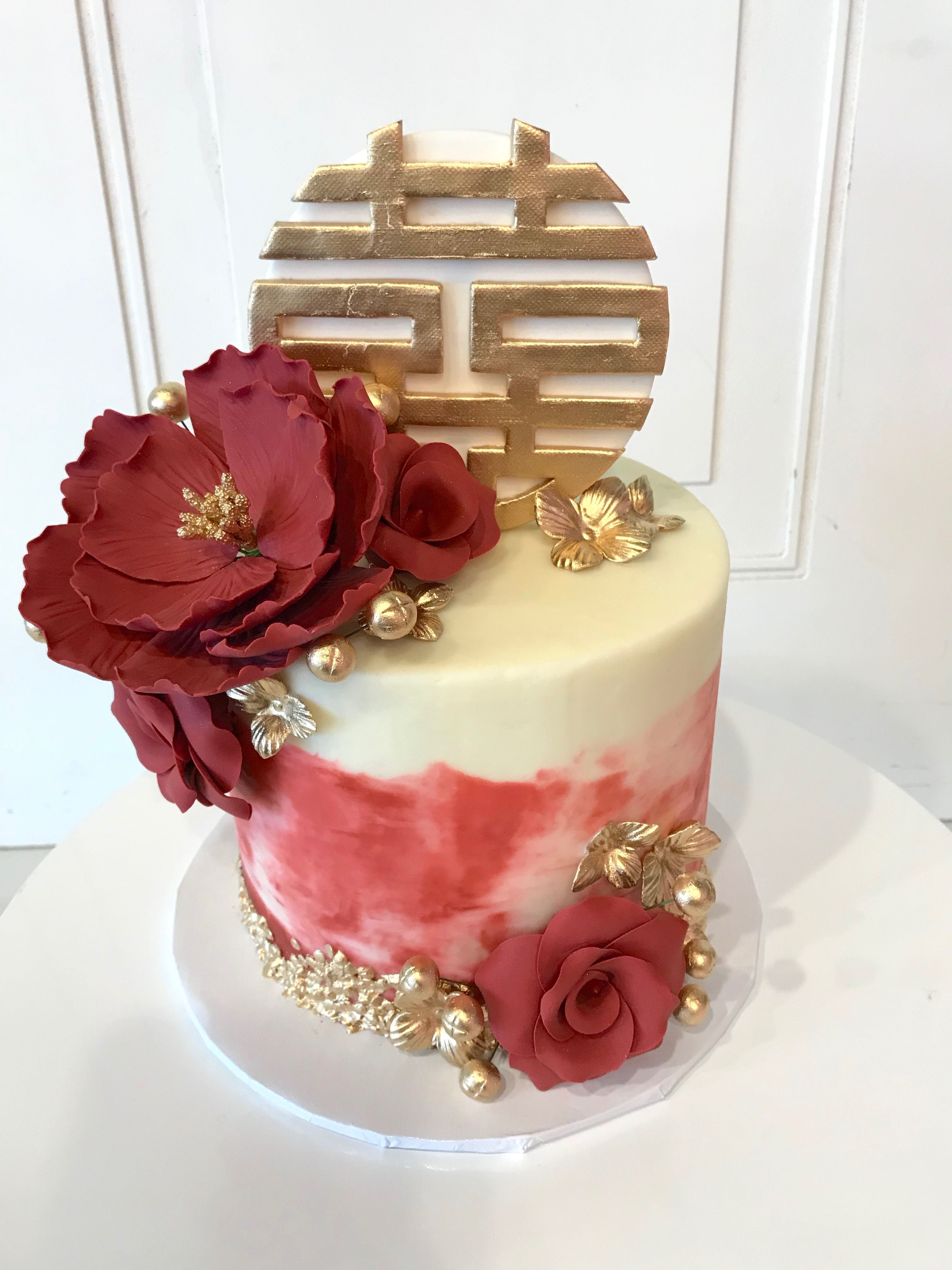 Wedding Cake Made By 3 Sweet Girls Cakery With Red Flowers And Gold Accents It Has The Double Happiness Chinese Symbol Wedding Cakes Cake Themed Wedding Cakes
