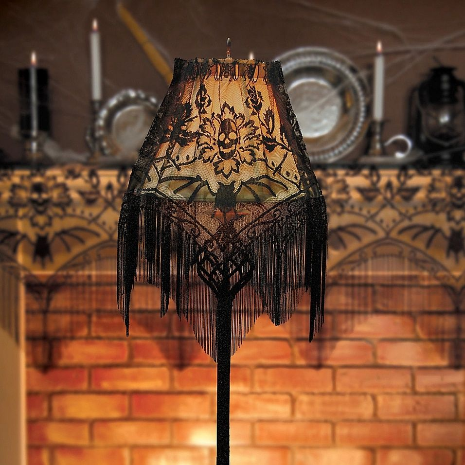 Heritage Lace Halloween Gala Door Swag Black - Spook up your Halloween décor with the Heritage Lace Halloween Gala Door Swag. Black fringe hangs from the versatile piece that combines a creepy blend of spiders, skulls, and bats. Can be used as a valance, door swag, or lampshade topper.