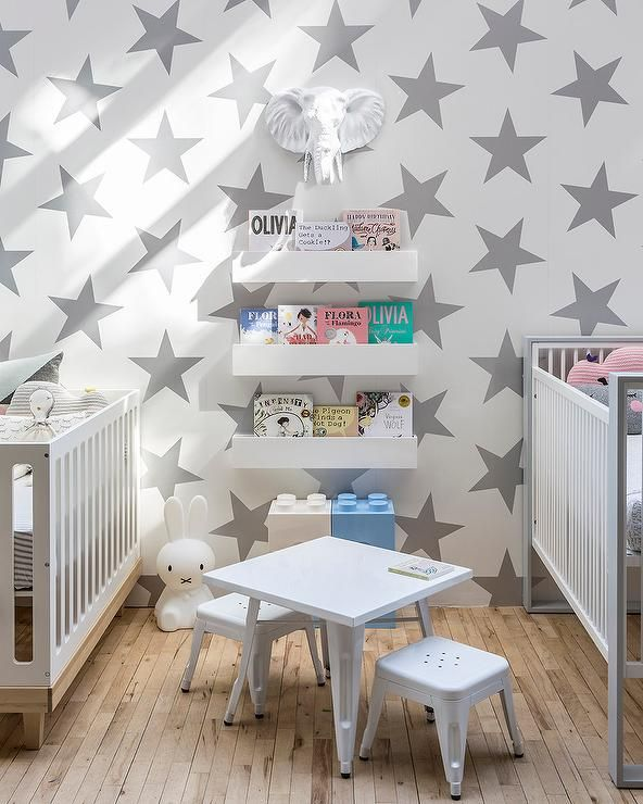 Nursery Room With Double Cribs And Stars Wallpaper Enhance The Look Of Your Baby S
