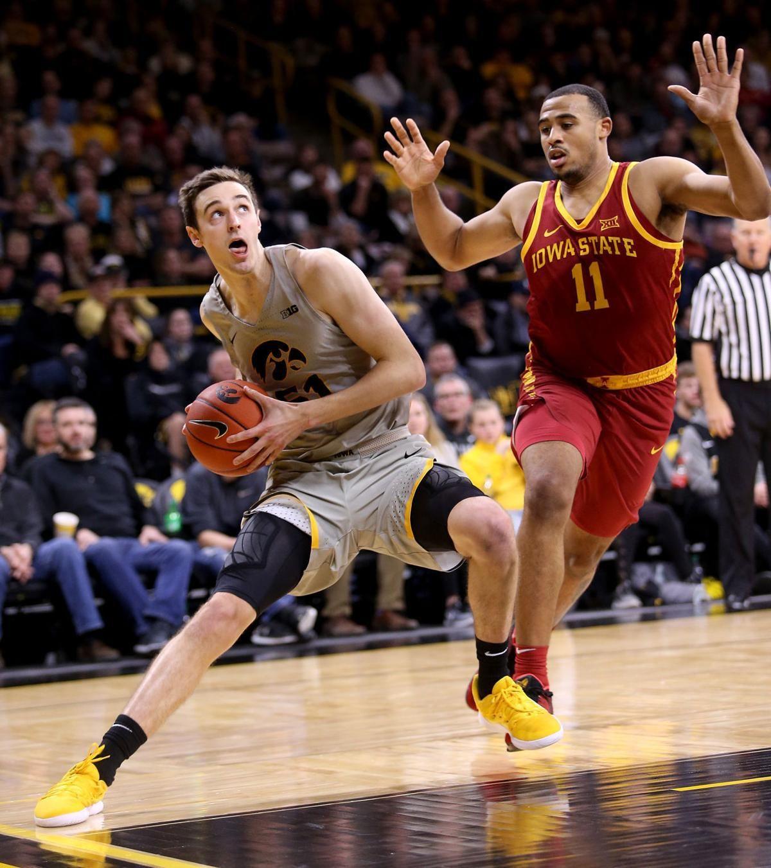 Photos Iowa Beats Iowa State 98 84 In Men S Basketball Iowa State Iowa Mens Basketball