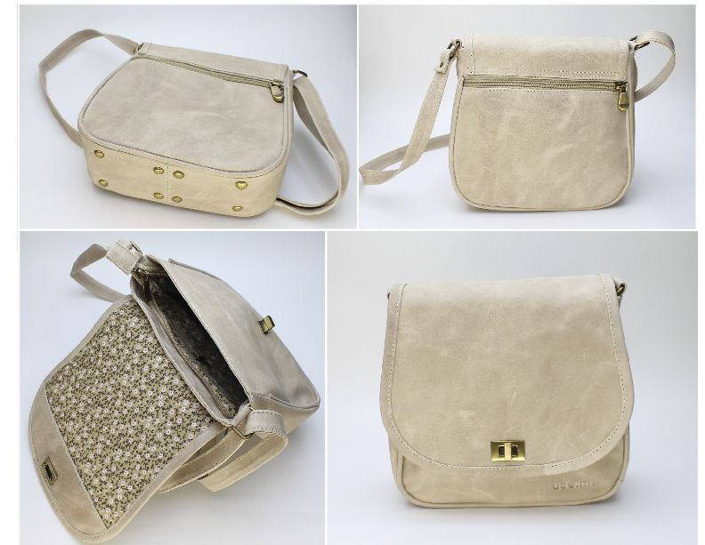 BEIGE FLAP. EXTERIOR: Made of beige Vachetta Leather. Antique brass rectangle turn lock. Metal-nished zippers. Rectangular metal rings. External zipper pocket. Antique brass metal studs. INTERIOR: Printed lining. One Pocket for cell phone or glasses. One zipper pocket.