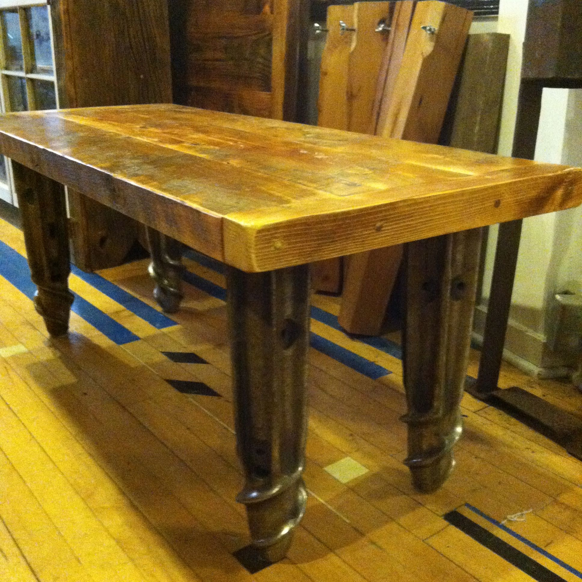 Repurposed salvage barn wood coffee table with salvage industrial