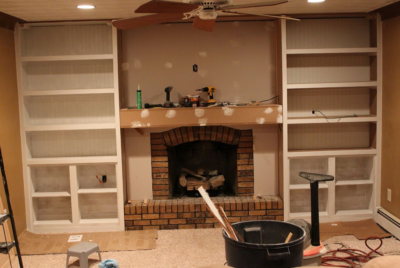 custom built in cabinets around fireplace and a ceiling fan in that rh pinterest it Built in Bookcases around Fireplace Ideas for Cabinets around Fireplace