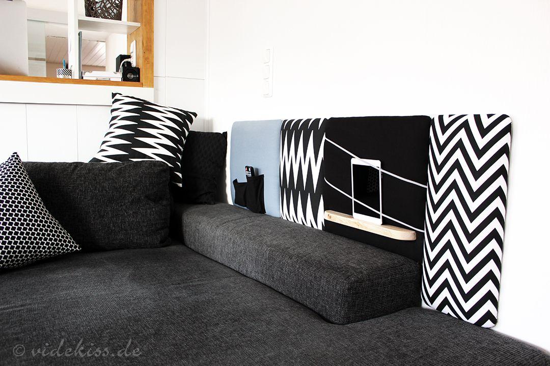 Mit wenig handwerklichem Geschick und einfachen Materialien lässt sich ein solches stylisches Wandpolster zum Beispiel neben dem Sofa gestalten. Es würde aber auch etwas