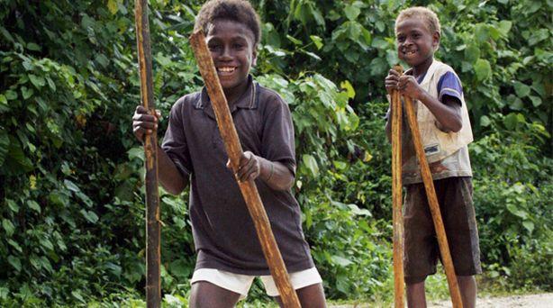 Boys enjoying walking on stilts in Solomon Islands. Photo by Rob Maccoll for…