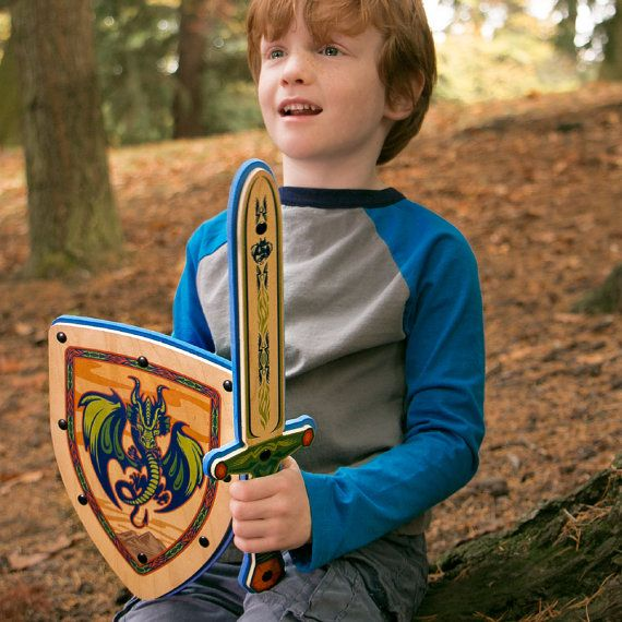Wooden Toy Sword featuring our vivid Dragon design, handmade in Portland, Oregon (USA) using non-toxic, formaldehyde free maple hardwood and soft EVA foam. The perfect present for any kid that dreams of being a knight. #woodentoys #toys #pretendplay #madeinUSA #knights