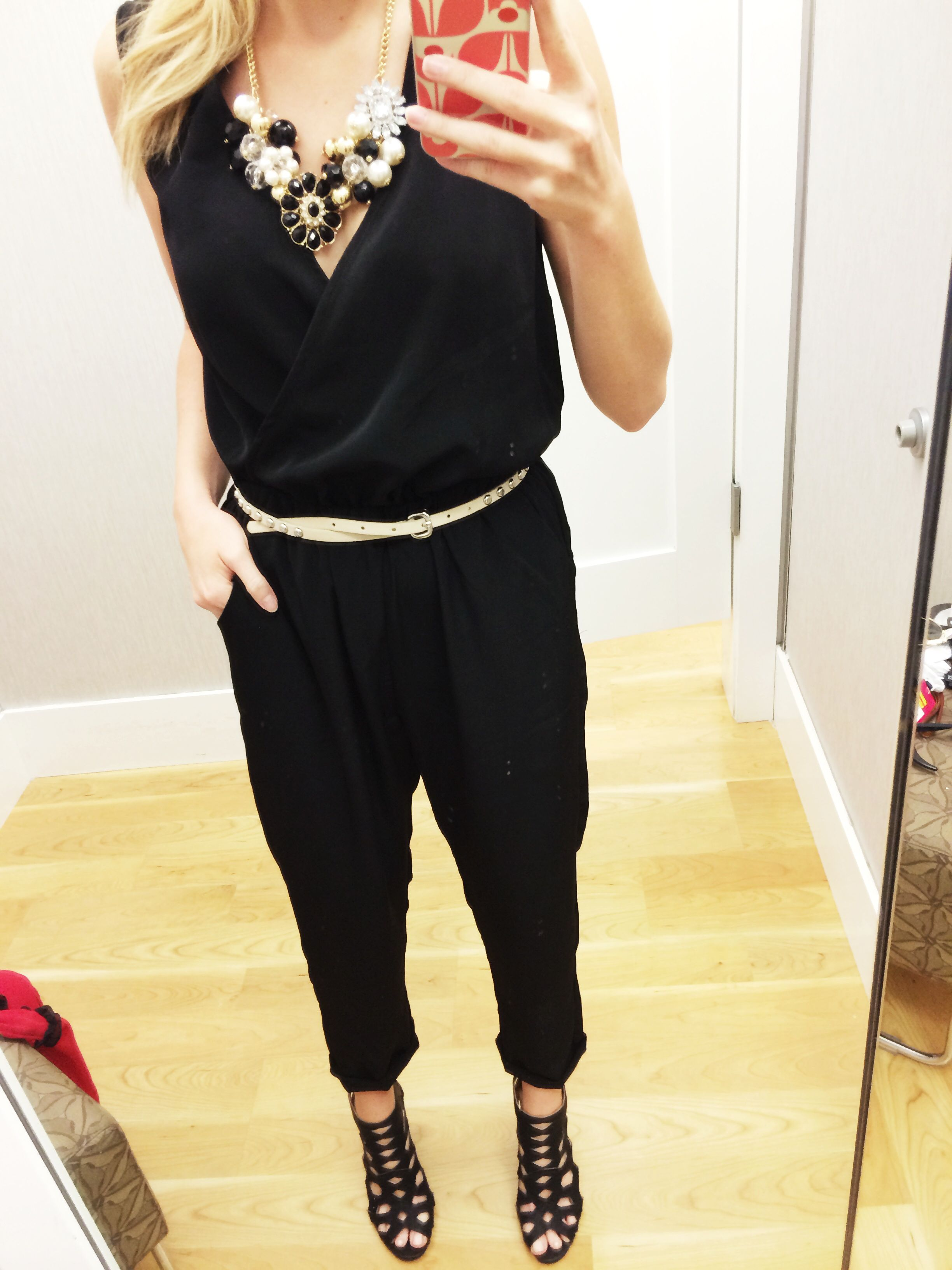 66c1df8f00 Black Jumpsuit with black and white necklace