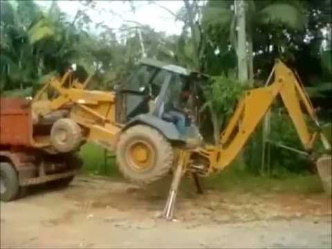 How to Load a JCB Backhoe on a Dump Truck Without a Ramp
