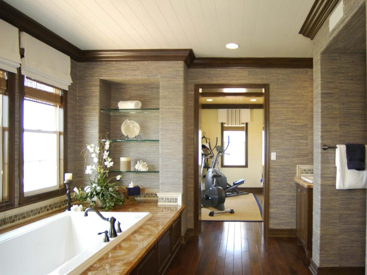 Textured wallpaper punctuated by dark wood trim gives this