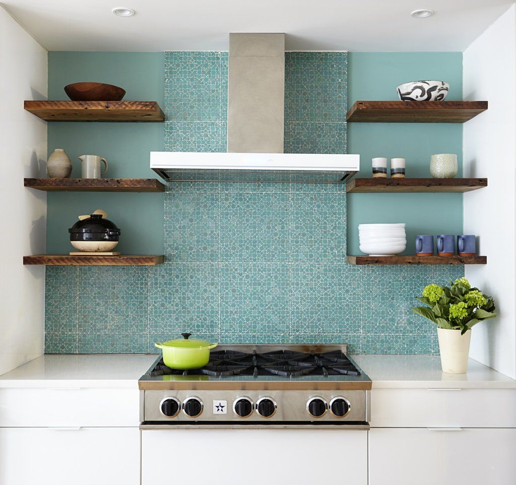 IKEA cabinets in the kitchen have an off-white soapstone countertop ...