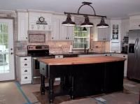This custom kitchen design and remodel was complete in 2010, with a Tuscan feel... Wellborn Cabinetry and black butcher block island complete this look, with mosaic tile backsplash and wood flooring.