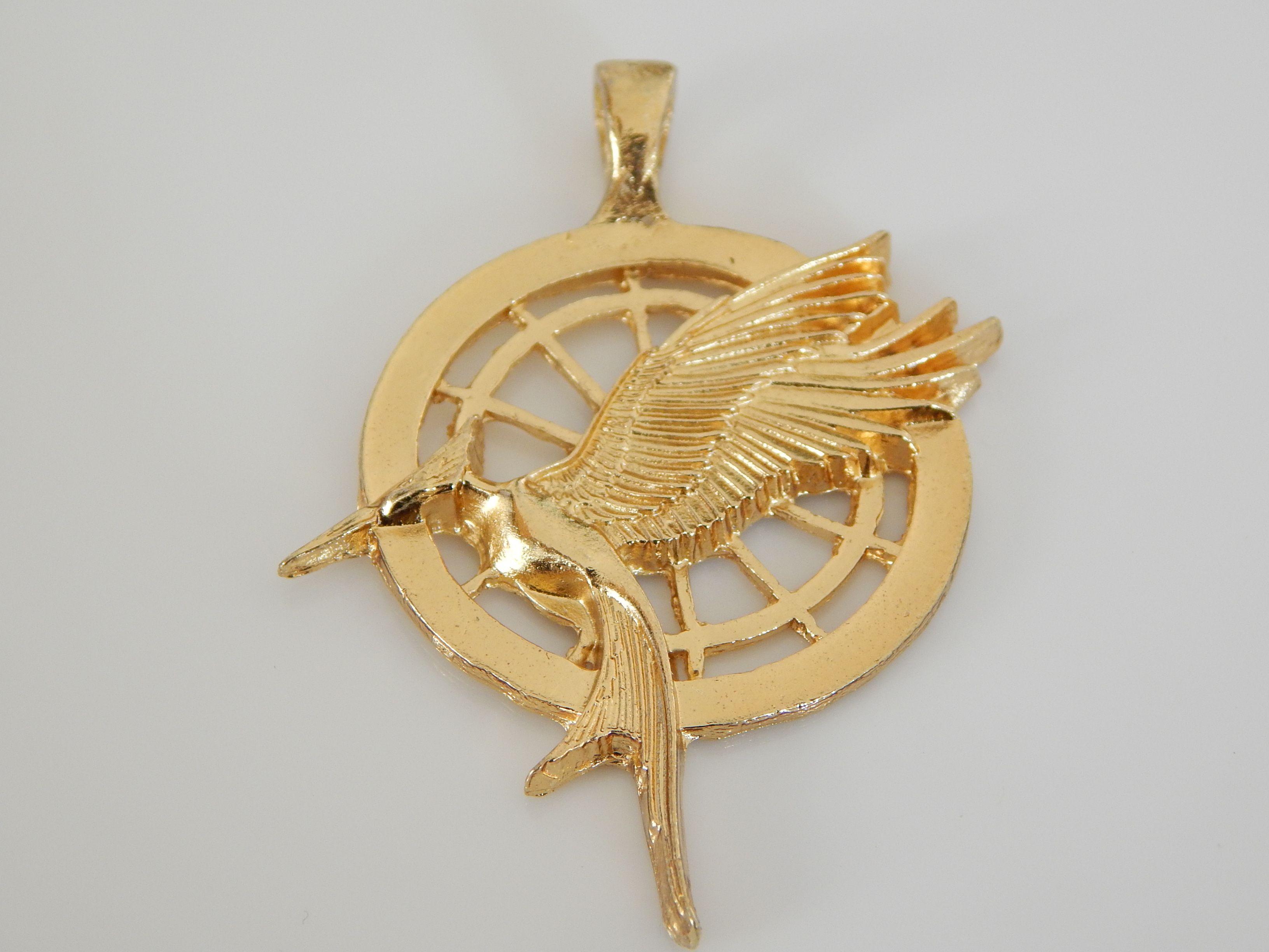 Sinsajo dije para collar dorado, medida 3.5cm de diámetro, HER0011  precio x pieza $18, HER0012-1/2 docena $99, HER0013- 1 docena $170