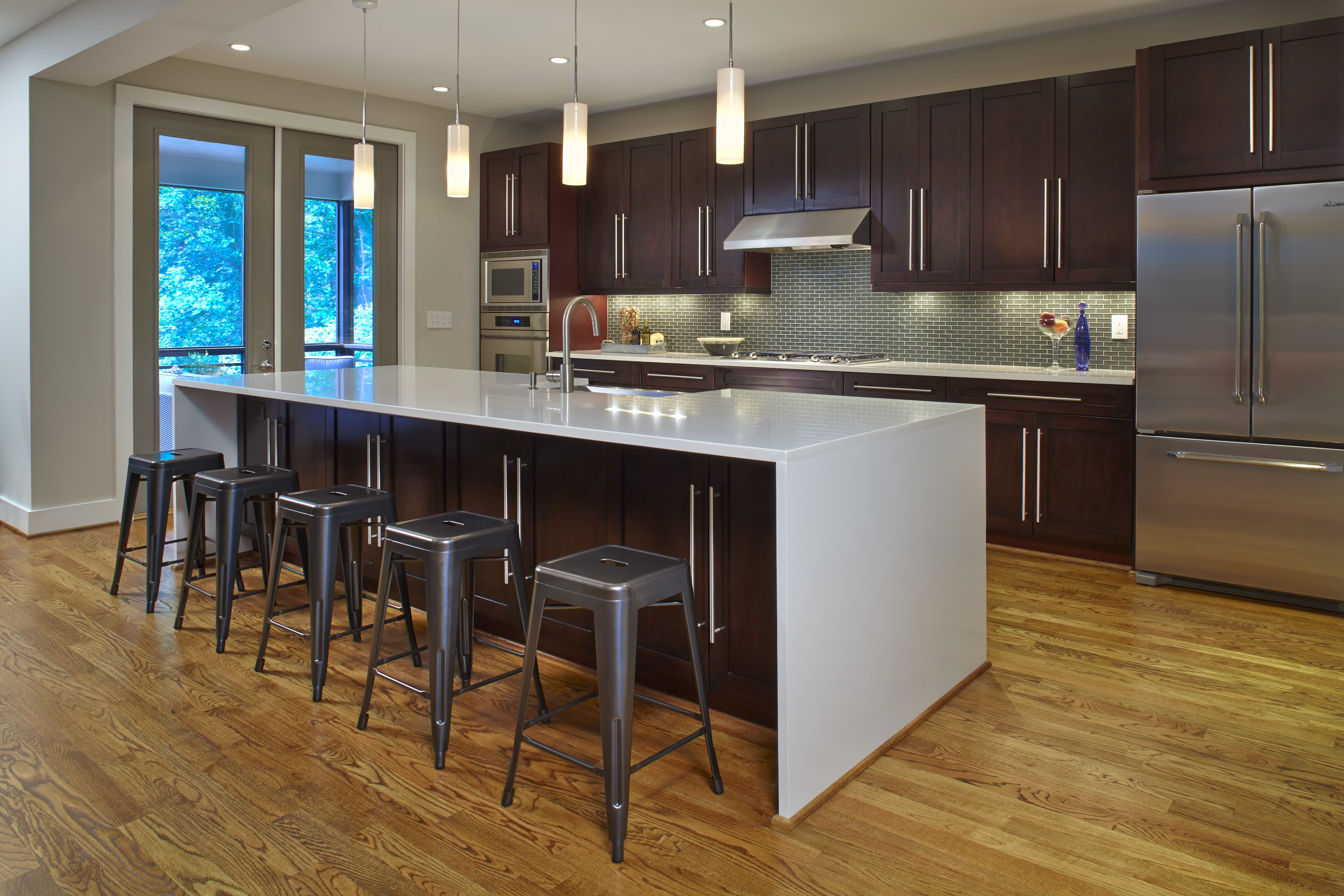 This modern kitchen in a recently built modern prairie for Stainless steel countertop with built in sink