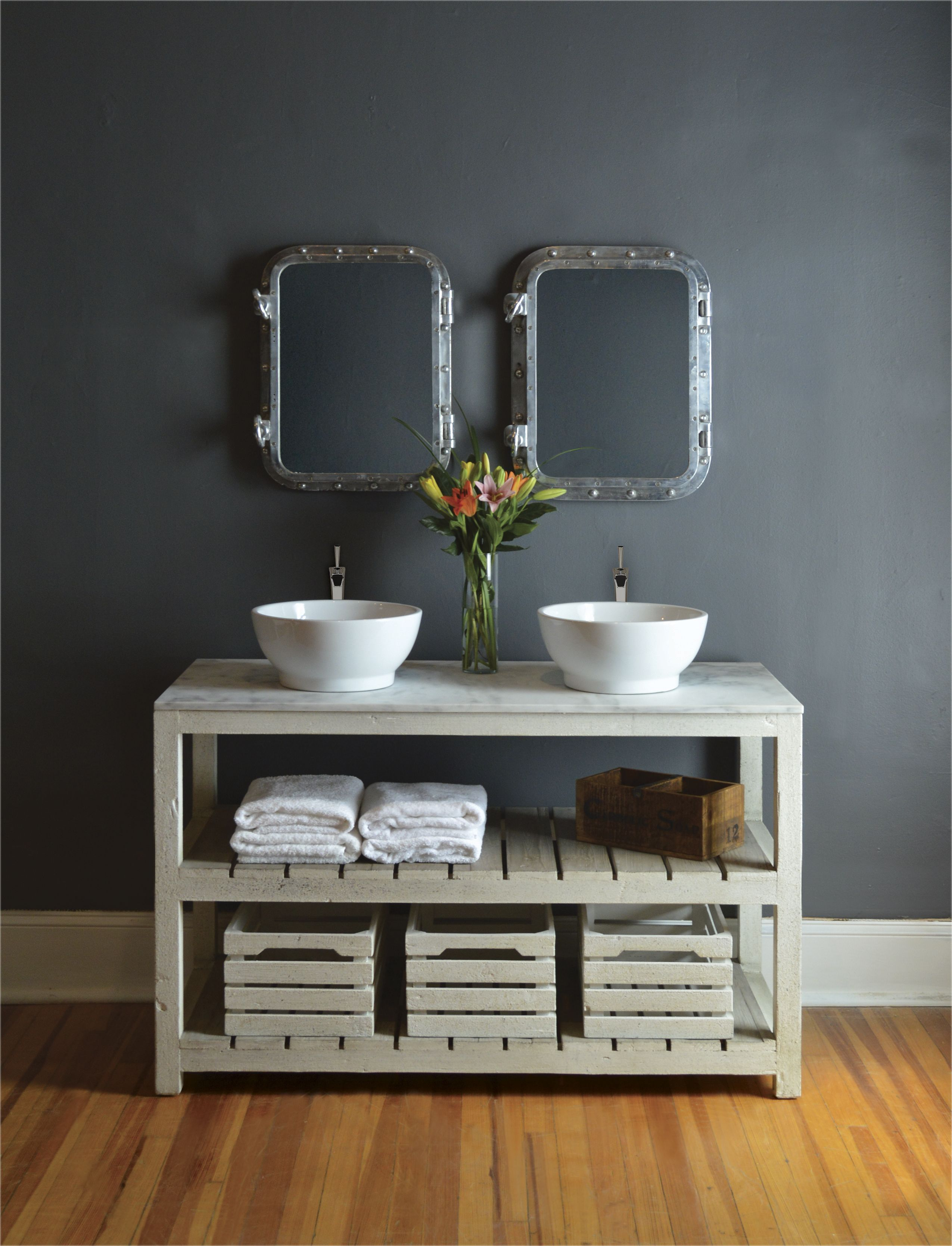 Antique white slatted vanity with carrara marble top and