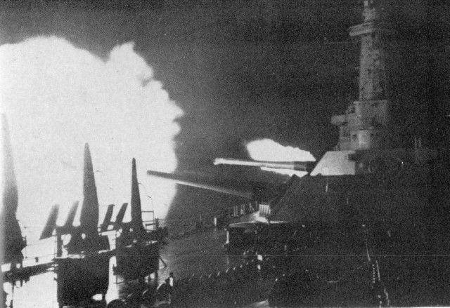 The U.S. battleship Washington fires at the Japanese battleship Kirishima
