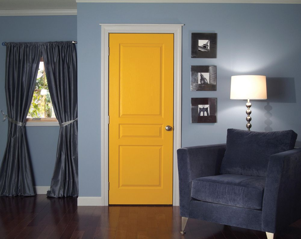 Charming Yellow Interior Door In Living Room With Curtains And Wooden Flooring Furnished Blue Lounge