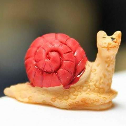 Micro snail. www.teeliesfairygarden.com . . . Your fairies wouldn't be able to get enough of this cute micro snail. He'll be excited to crawl into your fairy garden. #fairysnail