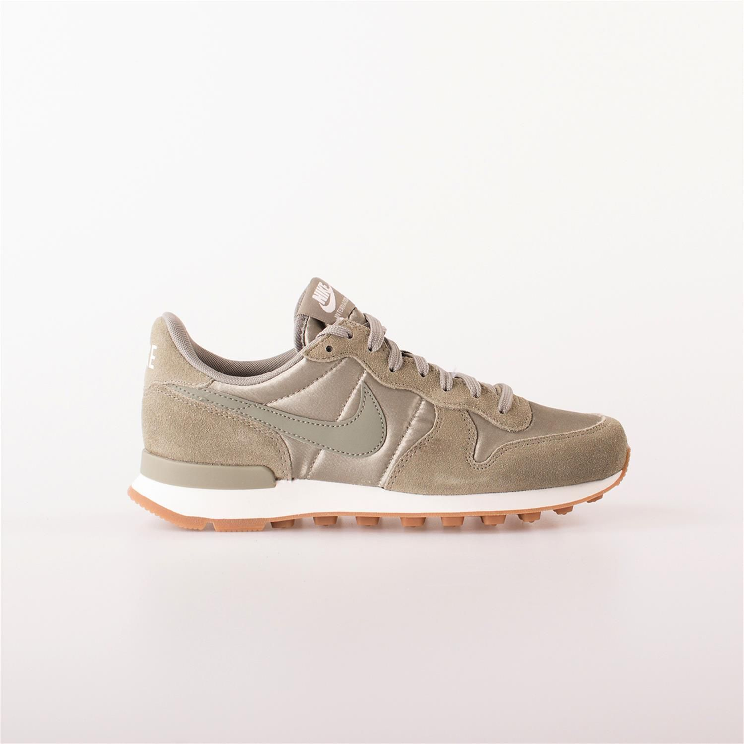 nike internationalist dames wit goud