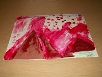 By cutting the volcano and painting the red of the lava, the students are working on their fine motor skills. By working with their hands, they learn in a meaningful way about the physical features of other parts of the world (volcanoes).