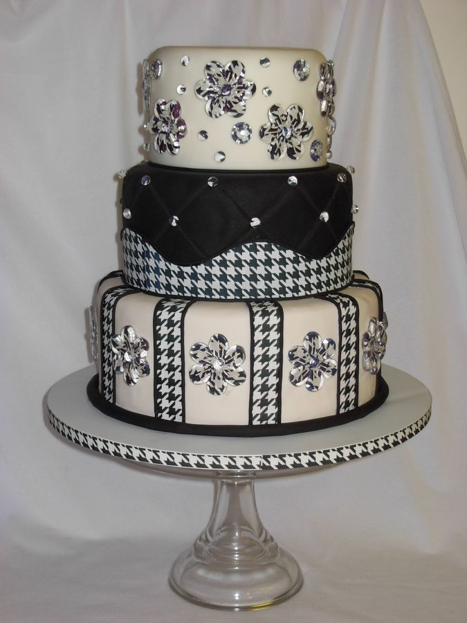 Simicakes really nice work! covered the cake in fondant and quilted the middle tier. Used Icing Images for a fabric effect and suspended more icing images in isomalt flowers and beads.  Enjoy! Wedding cake? Beautiful artwork