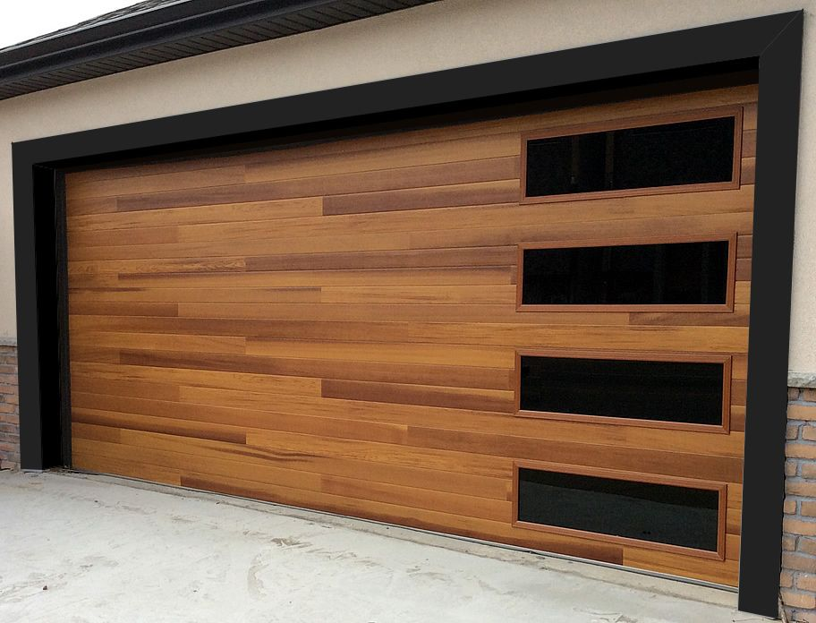 Accent Planks On This C H I Cedar Door Make It A Strong Statement Piece But The Timeless Beau Garage Door Design Garage Door Colors Contemporary Garage Doors