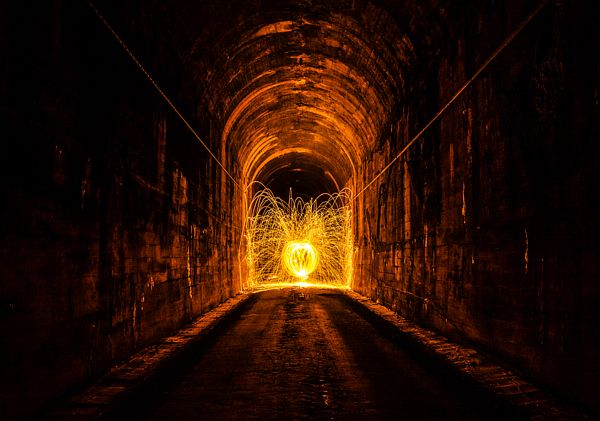 Tunnel Sparks A long exposure of sparks shooting off in a tunnel from burning steel wool. long exposure sparks shooting tunnel burning steel wool