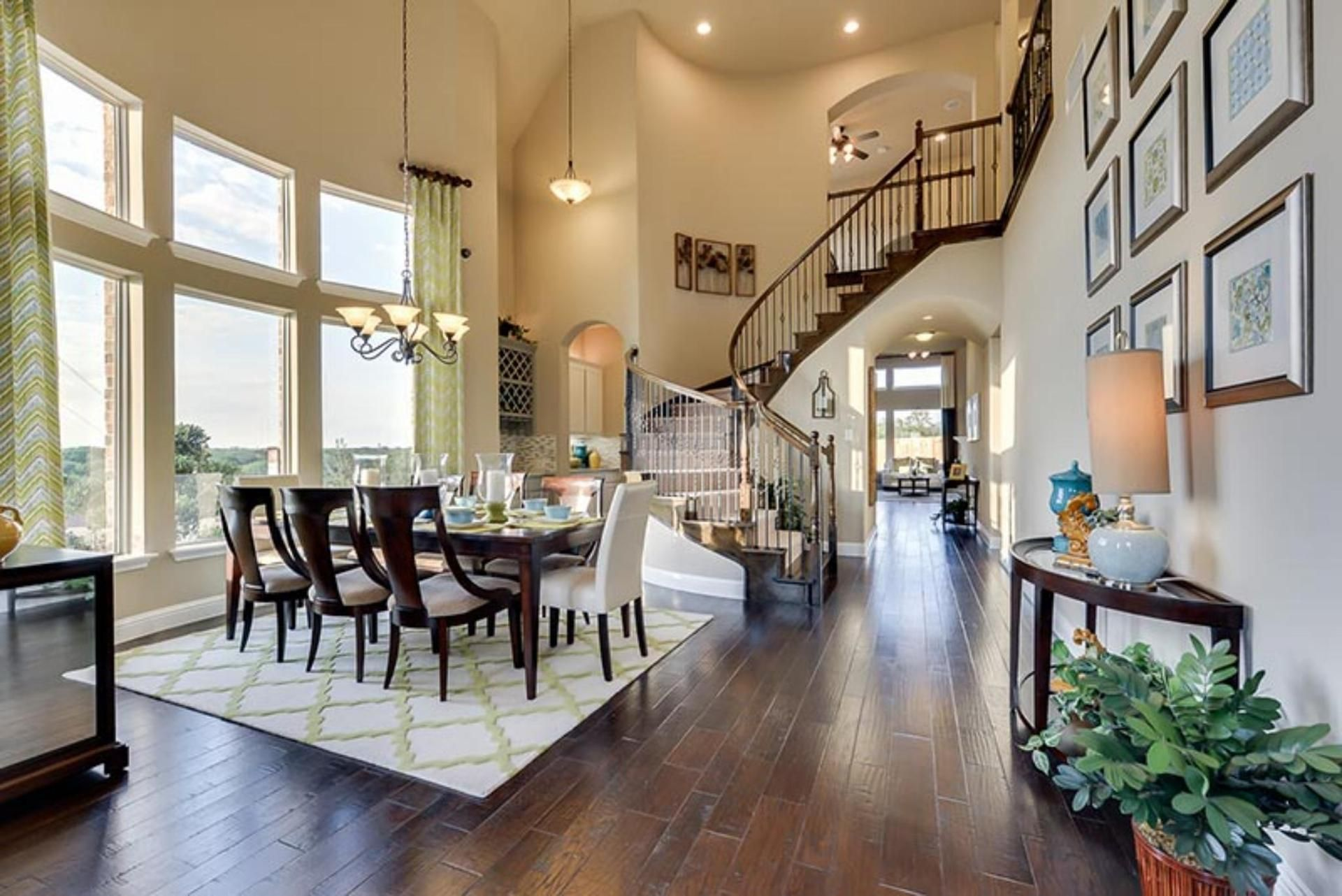 A Graceful Spiral Stairway Defines The Annabelle Plan New Home Built By Dunhill Homes Heath Golf Yacht Club Tx
