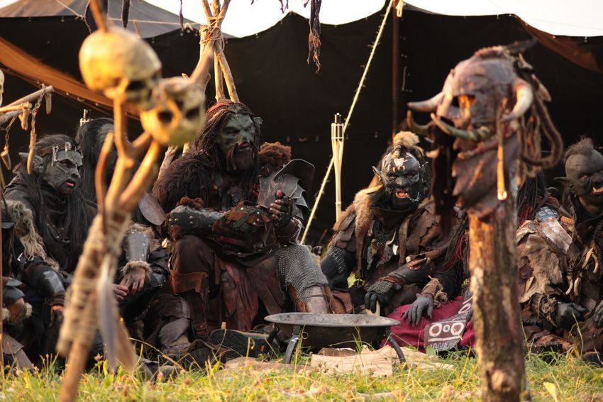 Nice costumes, but I really like that they took the time to gather the skulls, the cooking brazier and other props.