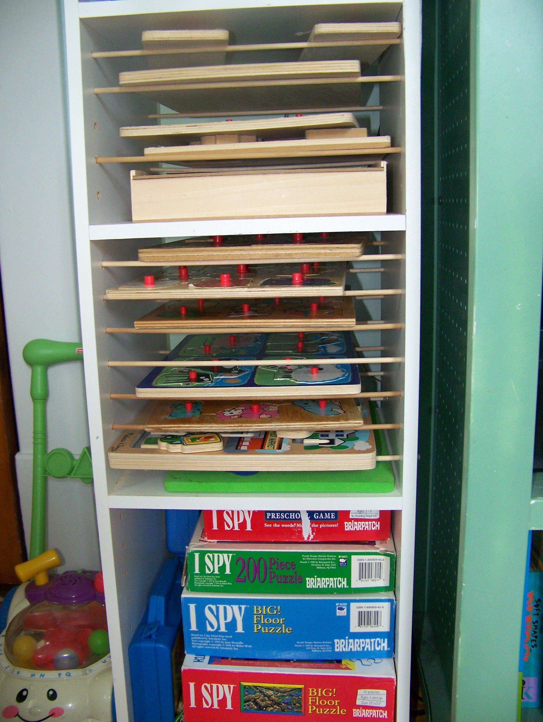 Puzzle rack out of a pre-fab storage shelf } add small dowels to ...