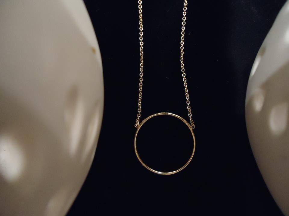 collier ras de cou avec anneau central