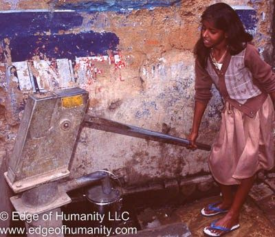 Indian girl gathering water.