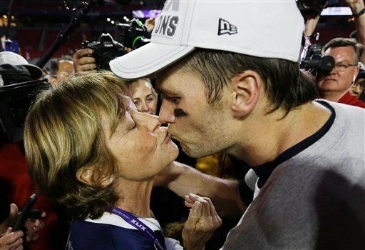New England Patriots quarterback Tom Brady (12) kisses his mother Galynn after the NFL Super Bowl XLIX football game.