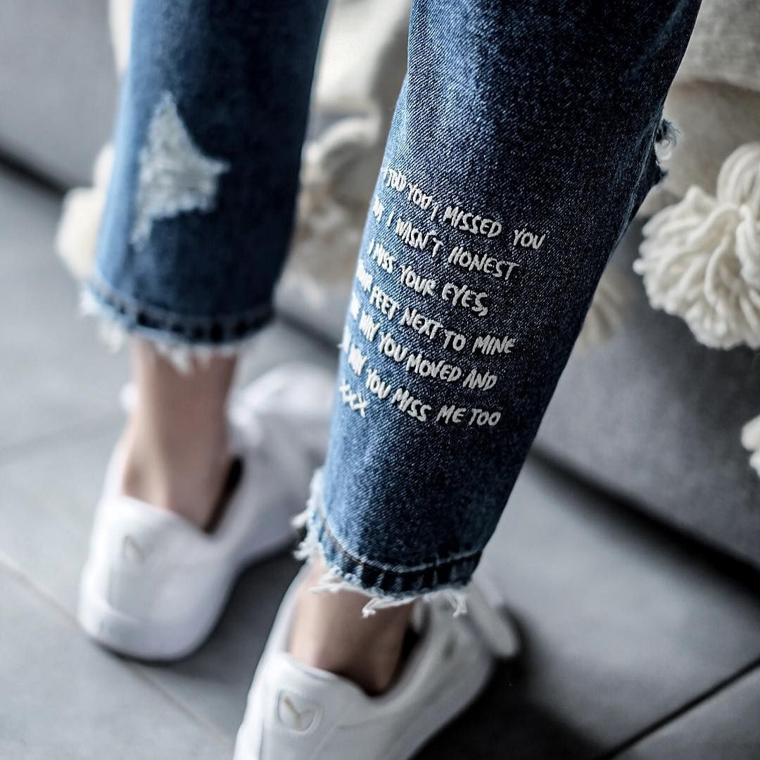Lovely idea - stitching words onto clothing item.