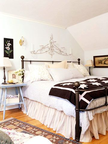 Love the art on the walls and the wrought iron above the bed