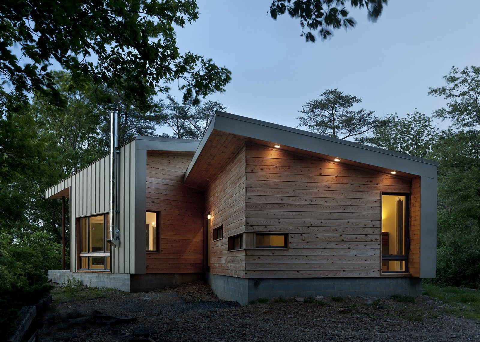 Modern Home With Exterior Wood Siding Material Metal