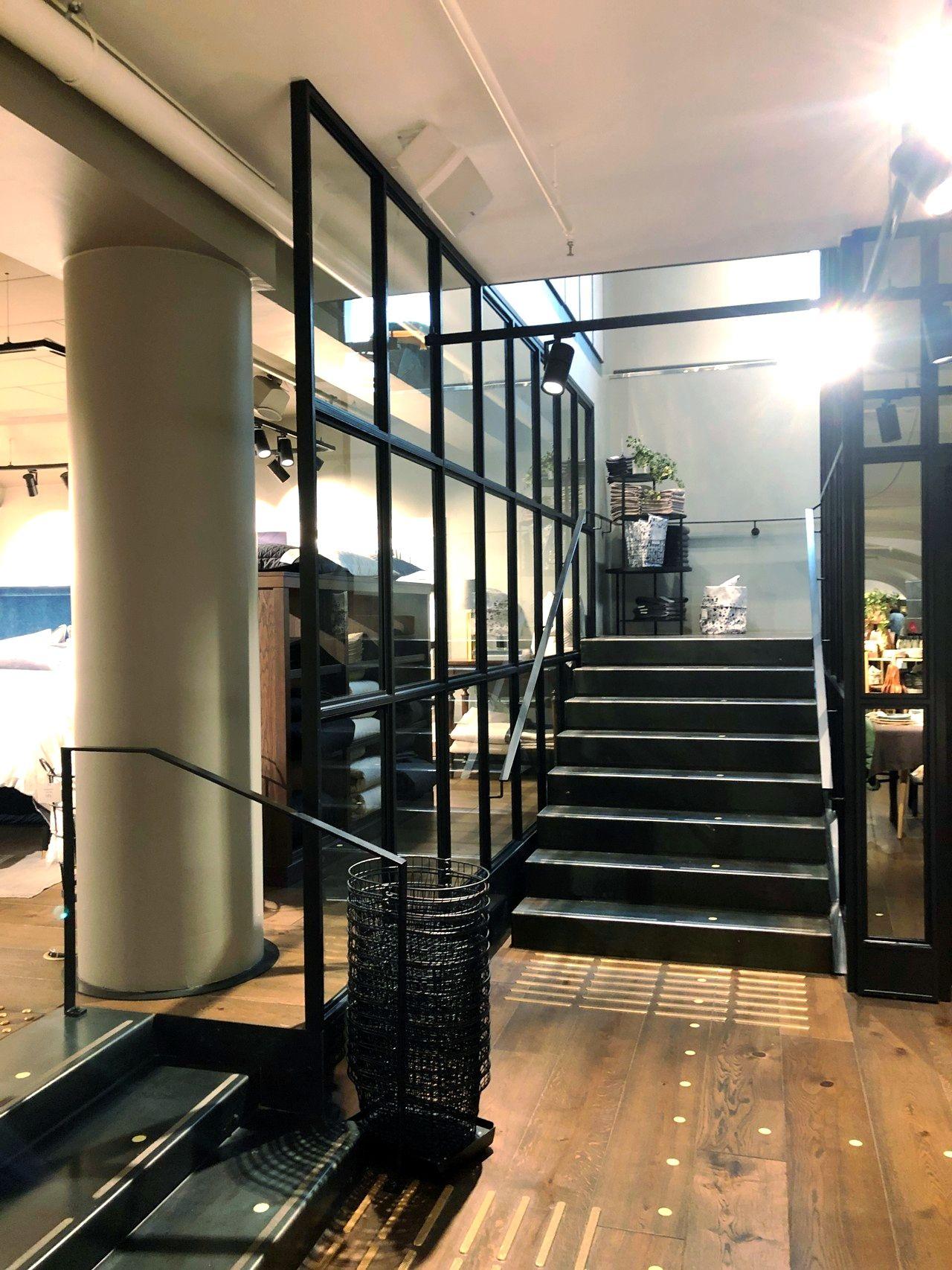 Glass and steel wall, steel stairs, steel railings, mirrors …