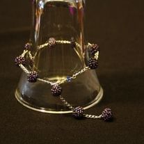 Purple clusters and chain equal a very pretty bracelet. Bracelet is adjustable and the largest it can go is 8 3/4 inches.