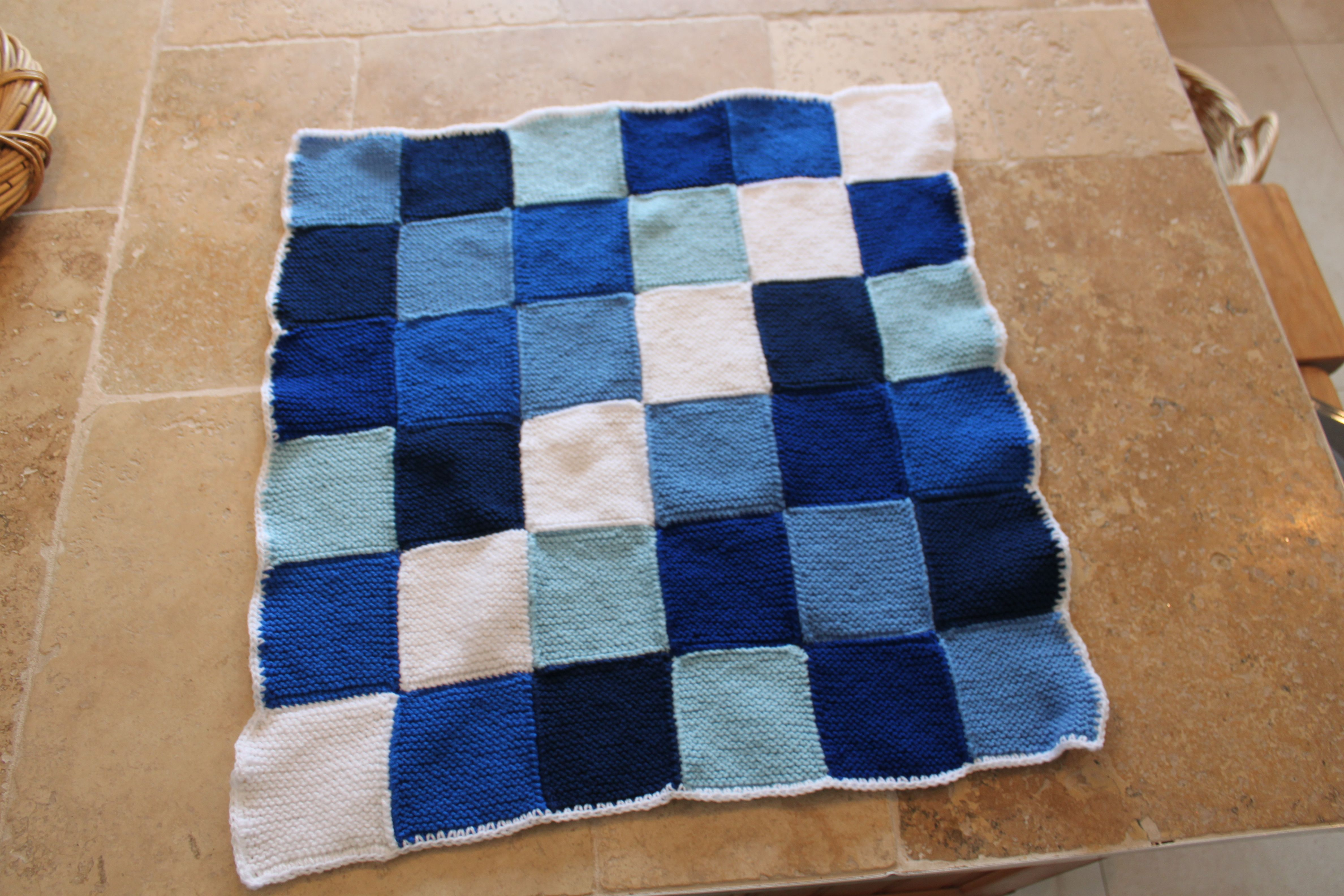Hand knitted baby patchwork blanket