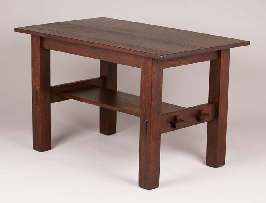 Gustav Stickley #433 library table with double tenon & key construction on each side.  Signed with paper label. Very nicely refinished.