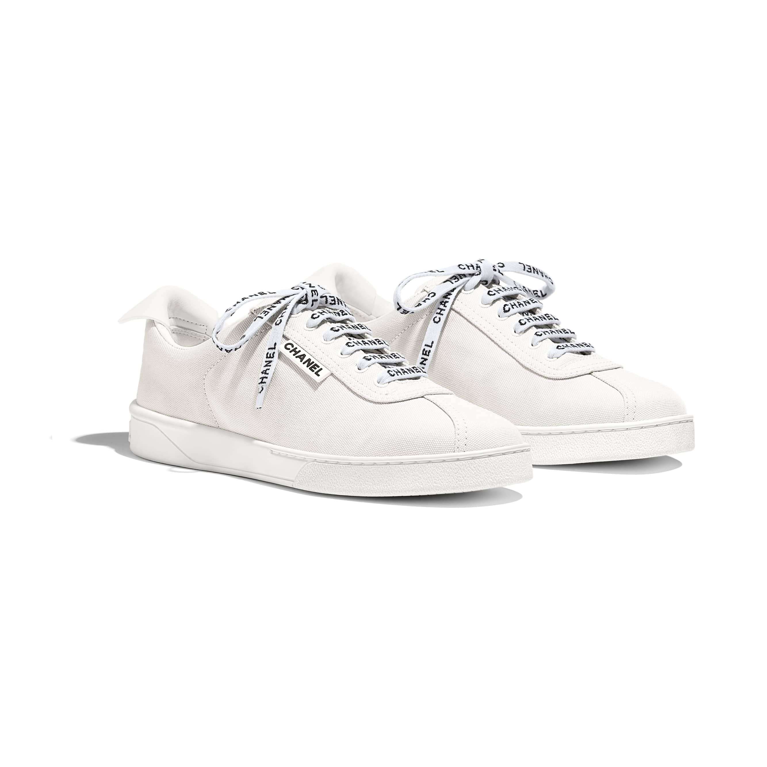 Ivory fabric sneakers ($850