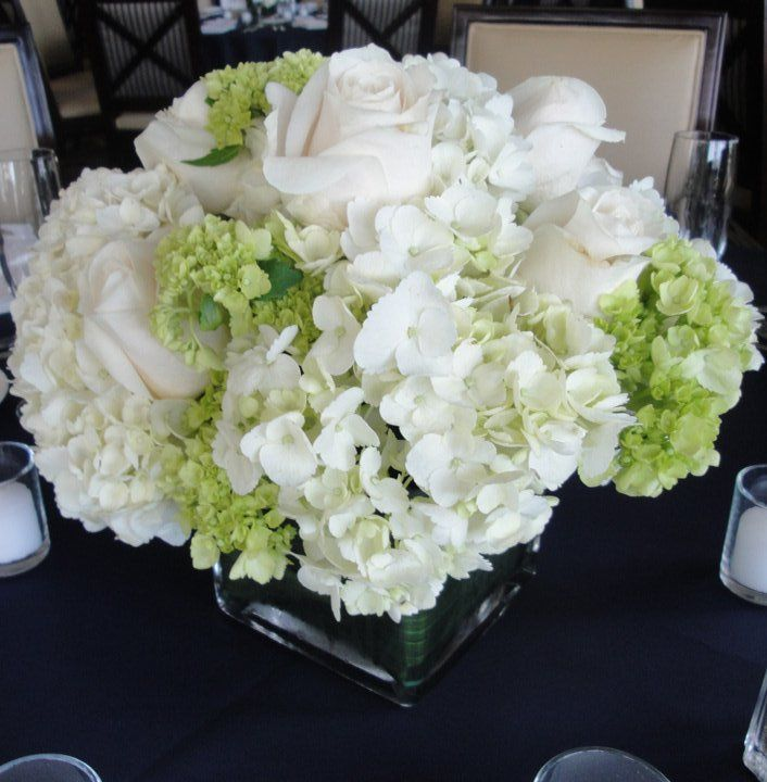 White hydrangea centerpieces with accents of mini green