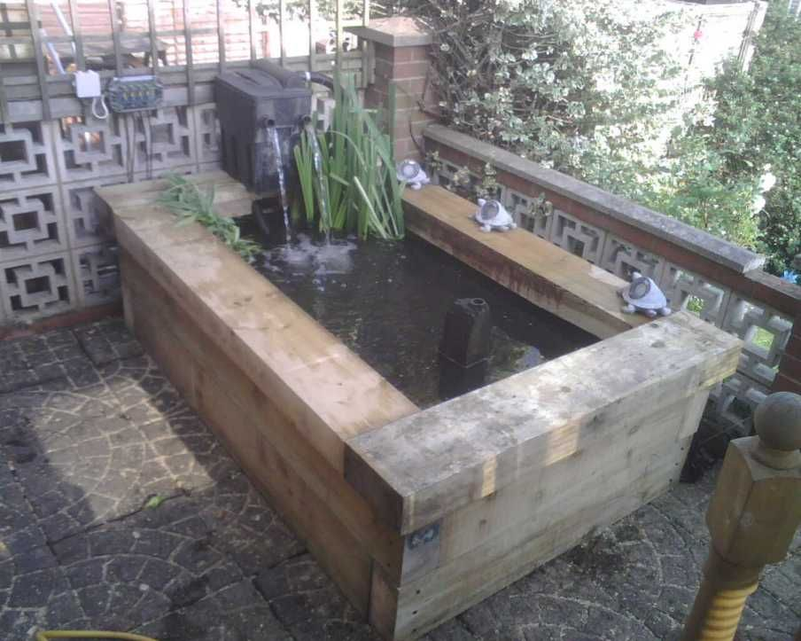 Chris foster 39 s raised pond with new pine railway sleepers for Garden pond design using sleepers