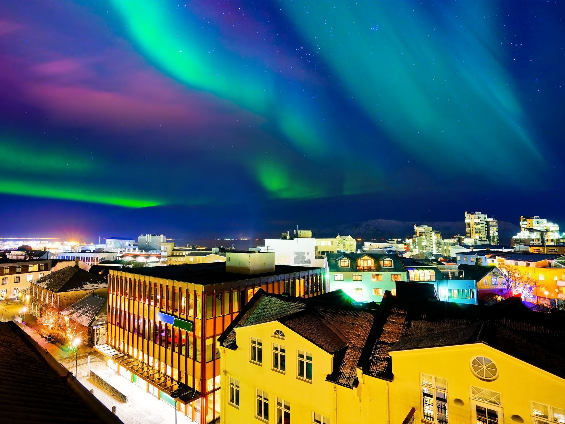 Northern Light From The City Center In Reykjavik Iceland   See the northern  lights, Northern lights, Iceland travel