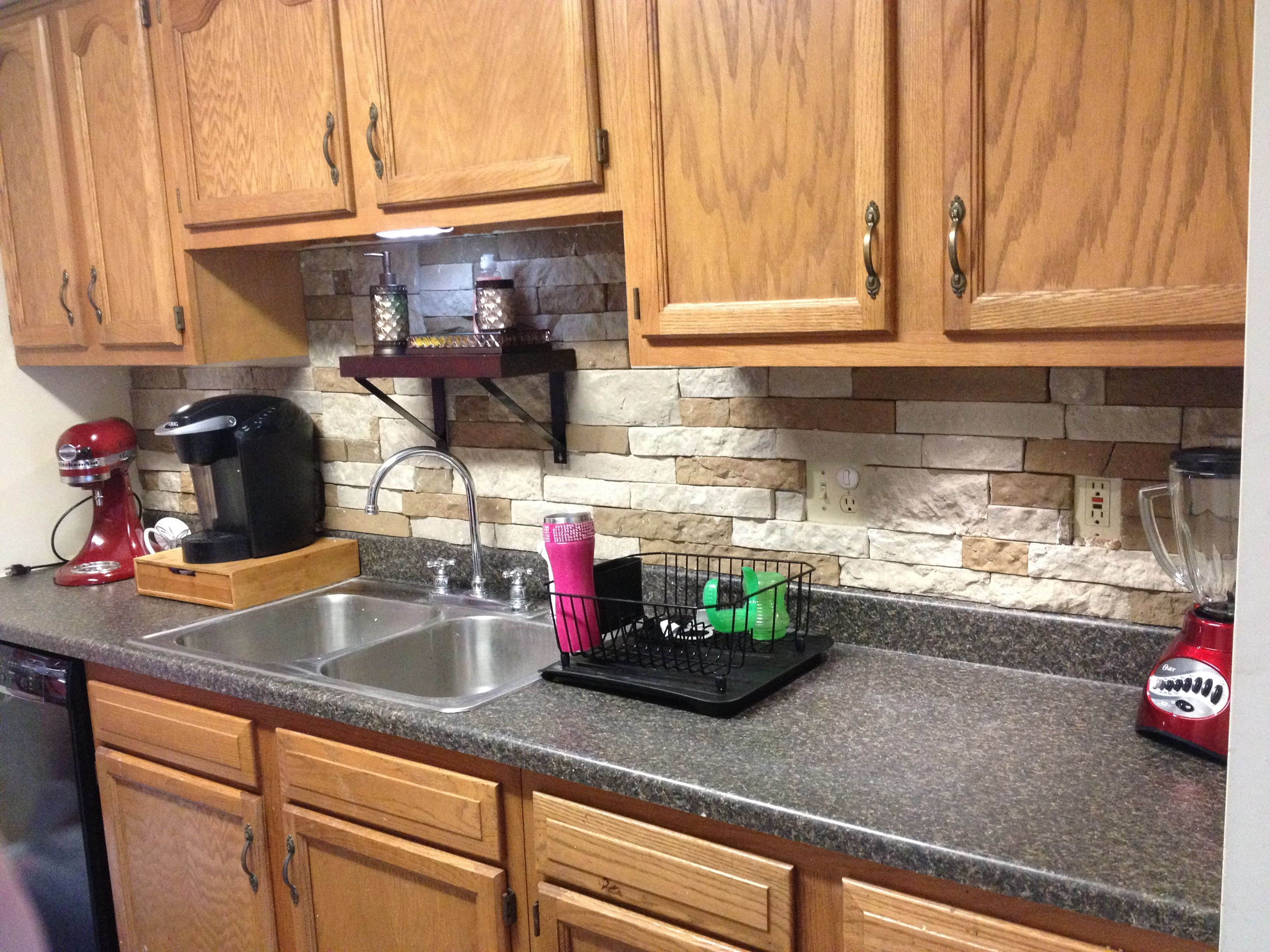 This is an Airstone backsplash Super easy and you can drill
